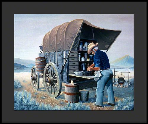 Cook preparing biscuits on the tailgate of a chuckwagon in the 1870's.